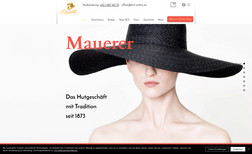Mauerer-Hut The website is about a local hat shop in the capit...